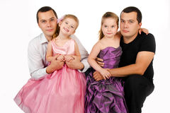 Portrait of two cute little girls with fathers Royalty Free Stock Photography