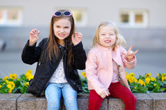 Portrait of two cute little sisters outdoors Stock Photos