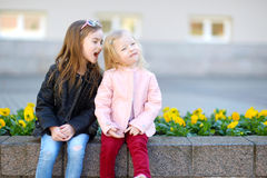 Portrait of two cute little sisters outdoors Stock Image