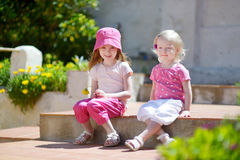 Portrait of two cute little sisters outdoors Royalty Free Stock Photos