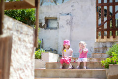 Portrait of two cute little sisters outdoors Royalty Free Stock Image