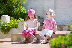 Portrait of two cute little sisters outdoors Stock Photo