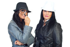 Portrait of two detectives women royalty free stock photos