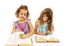 Portrait of two diligent girls at workplace Royalty Free Stock Photo