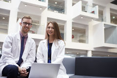 Portrait Of Two Doctors Meeting In Hospital Reception Area stock photos