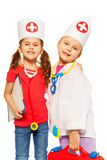 Portrait of two doctors playing with medical tools Stock Photo