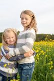 Portrait of two embracing cute little girls Stock Image