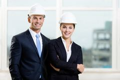 Portrait of two engineers. Standing near each other Royalty Free Stock Image