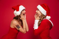 Portrait of two excited happy girls in christmas dresses Royalty Free Stock Photography
