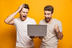 Portrait of a two excited young men best friends stock photography