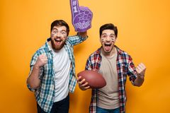 Portrait of a two excited young men stock photo