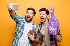 Portrait of a two excited young men taking a selfie royalty free stock photo