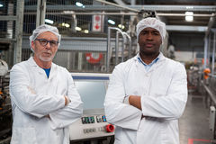 Portrait of two factory engineers standing with arms crossed Stock Photos