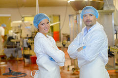 Portrait two factory workers stood with arms crossed Royalty Free Stock Photography