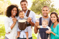 Portrait Of Two Families With Baby Carriers In Park Royalty Free Stock Photos