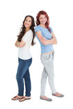 Portrait of two female friends with arms crossed Stock Image