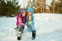 Two female friends walking in the winter. Portrait of two female friends walking in the winter Stock Photo