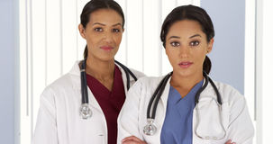 Portrait of two female Medical professionals in hospital Stock Images