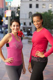Portrait Of Two Female Runners On Urban Street Stock Photos