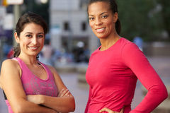 Portrait Of Two Female Runners On Urban Street Royalty Free Stock Images