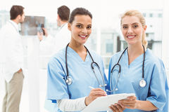 Portrait of two female surgeons with reports Stock Photos