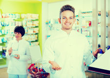 Portrait of two friendly glad pharmacists Royalty Free Stock Images