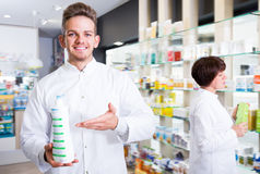 Portrait of two friendly laughing pharmacists Royalty Free Stock Photos