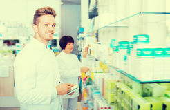 Portrait of two friendly ordinary pharmacists Stock Photography