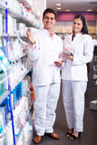 Portrait of two friendly pharmacists working Royalty Free Stock Photos