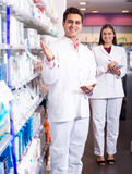 Portrait of two friendly pharmacists working Stock Photography