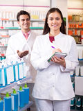 Portrait of two friendly pharmacists working Royalty Free Stock Photography