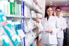 Portrait of two friendly pharmacists working Royalty Free Stock Image