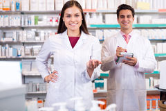 Portrait of two friendly pharmacists working Royalty Free Stock Images