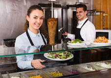 Portrait of two friendly workers with kebab Royalty Free Stock Images
