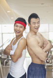 Portrait of two friends at the gym, arms crossed and smiling Royalty Free Stock Images