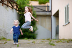 Portrait of two funny sisters outdoors Royalty Free Stock Images