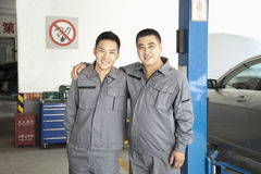 Portrait of Two Garage Mechanics Royalty Free Stock Images