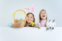 Girls with easter bunny. A portrait of two girls with an easter bunny stock images