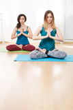 Portrait of two girls with eyes closed doing yoga exercise Stock Photography