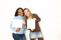 Portrait of Two girls holding blank signs. Portrait of two cute girls holding blank signs royalty free stock photos