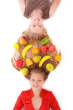 Portrait two girls with intertwined hairs and fruits Stock Images
