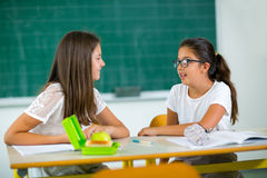 Portrait of two girls in the lunch break at the school Royalty Free Stock Photography