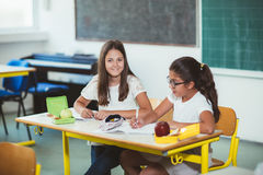 Portrait of two girls in the lunch break at the school Royalty Free Stock Image
