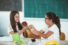 Portrait of two girls in the lunch break at the school Royalty Free Stock Photo