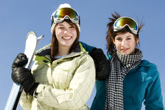 Portrait of two girls in ski gear Royalty Free Stock Image