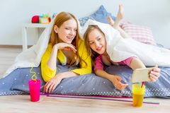 Girls at a sleepover. A portrait of two girls at a sleepover Stock Images