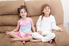 Portrait of two girls in the sofa Royalty Free Stock Photos