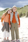 Portrait of two girls standing on beach Stock Photos