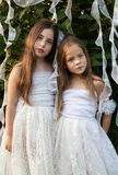 Portrait of two girls in white dresses in the garden Royalty Free Stock Photography