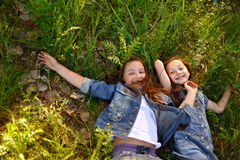 Portrait of two girls in the woods Royalty Free Stock Photography